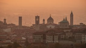 Bergamo, Italy. Morning landscape at the old town from Saint Vigilio hill during fall season stock image