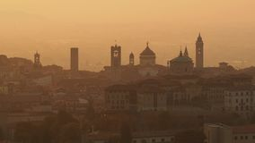 Bergamo, Italy. Morning landscape at the old town from Saint Vigilio hill during fall season stock footage