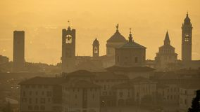 Bergamo, Italy. Morning landscape at the old town from Saint Vigilio hill during fall season royalty free stock photos