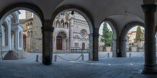 Bergamo portico of the palazzo della ragione l. Bergamo portico of the palazzo della ragione with a view of the Colleoni Chapel stock photo
