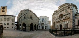 Bergamo portico of the palazzo della ragione l. Bergamo portico of the palazzo della ragione with a view of the Colleoni Chapel stock image