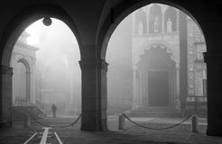 Bergamo - fog between Duomo and cathedral Royalty Free Stock Images