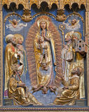 Bergamo - Relief of holy Mary and saints form church Chiesa del Carmine Royalty Free Stock Image