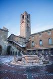 Bergamo - Torre del Comune in winter morning on the Piazza Vecchia Stock Image