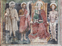 Bergamo - Virgin Mary and the saints from church Michele al pozzo bianco. Frescos of main nave is from year 1440 Stock Image