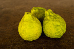 Bergamot  on brown background. Food Royalty Free Stock Images