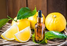 Bergamot citrus fruit essential oil, aromatherapy oil natural organic cosmetic. Fresh bergamot citrus fruits on rustic wooden background and bottle of essential stock photography