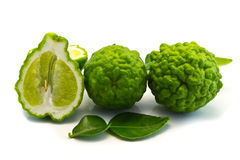 Bergamot cut half-and-half on white . Stock Photo