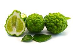 Bergamot cut half-and-half on white . Leech Lime cut half-and-half on white backgroun stock photo