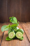 Bergamot with green leafs on wood background. Fresh Bergamot with green leafs on wood background stock image