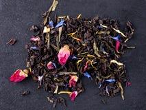 Bergamot green tea. On a black graphite tea royalty free stock images