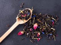 Bergamot green tea. On a black graphite tea royalty free stock photo