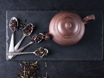 Bergamot green tea. And chinese teapot on a black graphite table royalty free stock photography