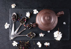 Bergamot green tea. And chinese teapot on a black graphite table royalty free stock photos