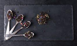 Bergamot green tea. In spoon on a black graphite board stock image
