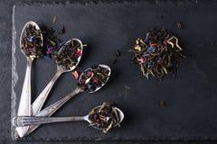 Bergamot green tea. In spoon on a black graphite board stock photography