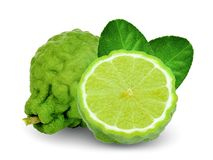 Bergamot with half and leaf isolated on white. Background royalty free stock photography