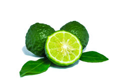 Bergamot. And kaffir lime leaves on white background stock photos