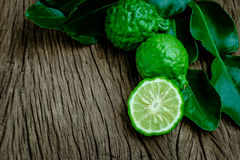 Bergamot. Lime, fresh on wooden.background royalty free stock photo