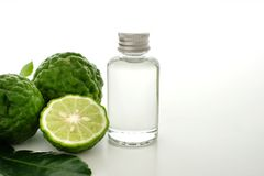 Bergamot oil and fresh bergamot. On white background royalty free stock image