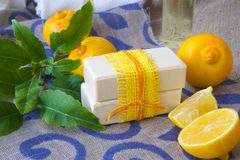 Bergamot soap. Soap with bergamot essential oil. Bergamot fruits in the background royalty free stock image