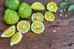Bergamot on wooden background. Bergamot on old wooden tables background Royalty Free Stock Photography