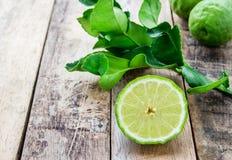 Bergamot on wooden table, (Kaffir lime) Stock Images