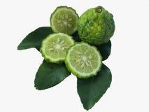 Bergamota pokrajać i owoc na bergamoty zieleni liściu Fotografia Stock