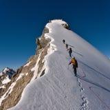 Bergbeklimmers op een waaier Stock Afbeeldingen