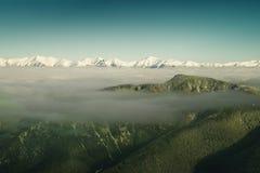 Berge über den Wolken Stockbilder