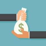 Übergeben Sie das Geben des Geldes Stockfoto