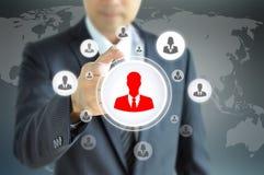 Übergeben Sie das Zeigen auf Geschäftsmannikone - Stunden- u. Einstellungskonzept Stockfotos