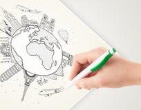 Übergeben Sie Zeichnungsurlaubsreise um die Erde mit Marksteinen und c Stockfoto