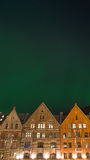 Bergen city under northern lights II Royalty Free Stock Images