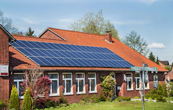 Bergen, Germany - April 30, 2017: Solar energy panel on a house roof on the blue sky background. Green renewable energy photovoltaic panel Royalty Free Stock Images