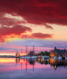 Bergen harbor with boats against colorful sunset in Norway, UNESCO World Heritage Site Royalty Free Stock Photo