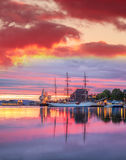 Bergen harbor with boats against colorful sunset in Norway, UNESCO World Heritage Site Royalty Free Stock Image