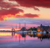 Bergen harbor with boats against colorful sunset in Norway, UNESCO World Heritage Site Royalty Free Stock Photography