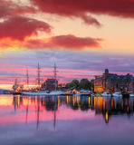 Bergen harbor with boats against colorful sunset in Norway, UNESCO World Heritage Site Stock Photo