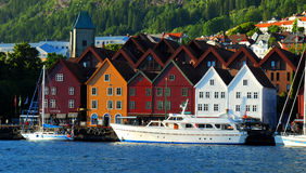 Bergen Norway. Boats lining the docks with colourful houses in Bergen, Norway, a UNESCO architectural heritage site Royalty Free Stock Photo