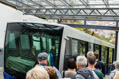 BERGEN, NORWAY - CIRCA 2016: Tourists wait for the famous Mount Floyen funicular to arrive. This train transports thousands of tou. Rists to the top to mount Royalty Free Stock Photos