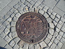 Bergen Norway Manhole Cover. Manhole in Bergen Norway with beautiful engraving Stock Photo