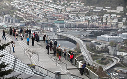 BERGEN, NORWAY - MAY 11, 2012: Tourists are looking down to Bergen from viewpoint Stock Photography