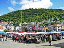 Bergen in Norway. People shop at the market in Bergen (Norway). At many of the market stalls fresh fish and seafood are offered. But there are also sold fruits stock photography