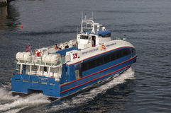 BERGEN/NORWAY - 21ST JUNE 2007 Rodne Fjordcruise ferry leaves Be. Rgen on a rare sunny day stock image