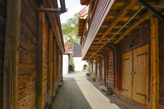 Bergen side street. The narrow gaps between the wooden warehouses open into small squares with bijou shops and boutiques Royalty Free Stock Image
