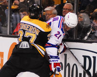 Bergeron pins Stepan against the boards. Royalty Free Stock Photo