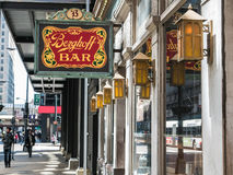 Berghoff Bar sign hanging over Adams Street in front of business Stock Photos
