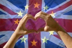 Übergibt Herzsymbol, Ausgang Großbritannien von der Europäischen Gemeinschaft Stockfotografie