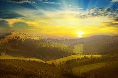 Berglandskap och soluppgång Fotografering för Bildbyråer